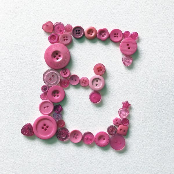 pink button initial letter