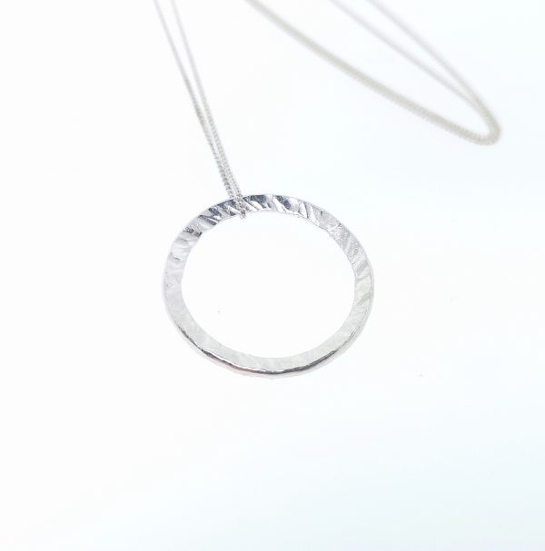 silver circle pendant handcrafted