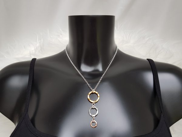 Contemporary necklace handmade with three graduated hammered rings in yellow and rose gold Vermeil and Sterling silver