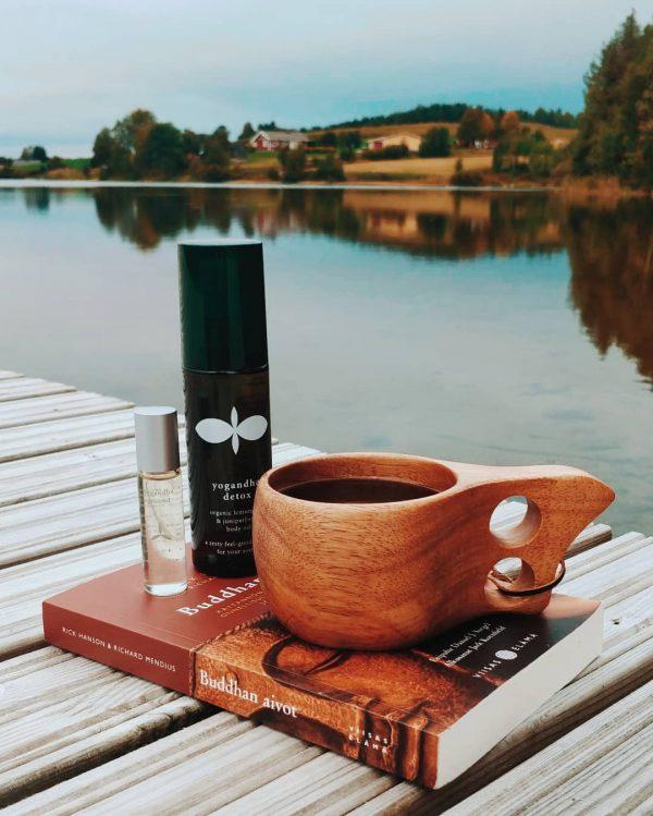Feel Restored Gift Set - 6. Detox oil near the lake lifestyle picture near books