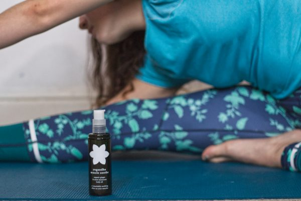Muscle Soothe Body Oil - 6.girl stretching while doing yoga and having yogandha muscl
