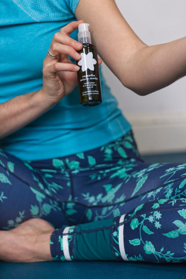Muscle Soothe Body Oil - 7. girl applying yogandha muscle soothe on body arms