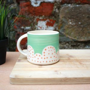 Polka dot turquoise and orange mug