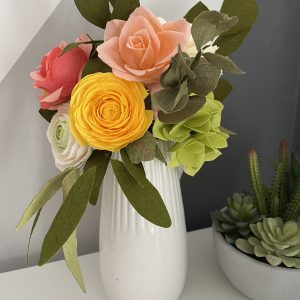 Crepe paper flower arrangement with roses, ranunculus and hydrangea