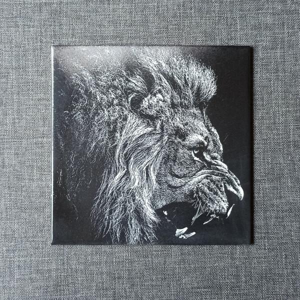 A Lion Head Engraved on Ceramic Tile
