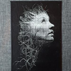 A Woman Portrait Engraved on Canvas