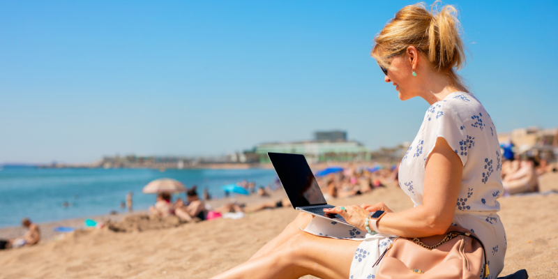woman shopping online on beach